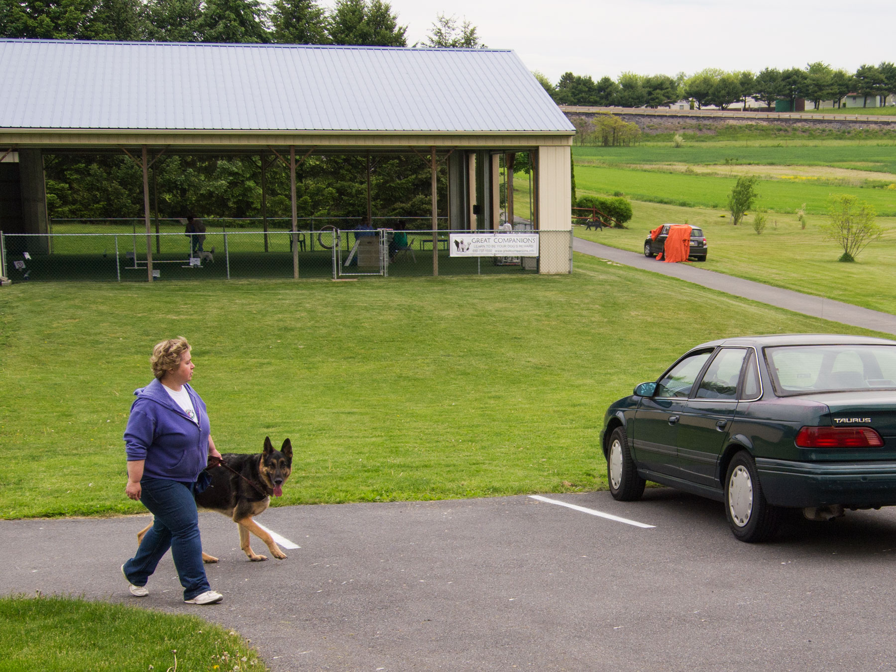 After their exercise, Michele and Rocky head back to their car for a few moments before beginning another round.